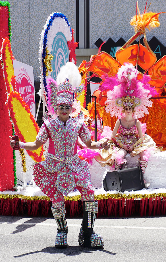 Hollywood Carnival Parade Float participants and Faroh rockstar hair designer