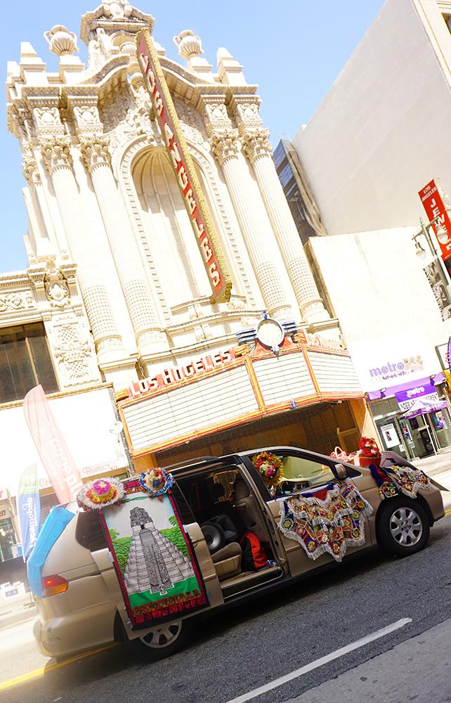 Ecuador Parade, Los Angeles, 08/04/19 Grupo Folklorico Eterna Primavera in front of historic Los Angeles theater on Broadway